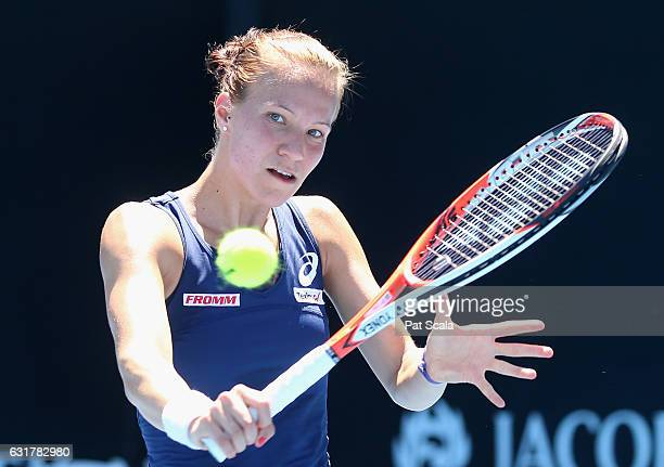 Viktorija Golubic of Switzerland plays a backhand during her first round match against Kristyna Pliskova of the Czech Republic on day one of the 2017...