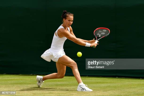 Viktorija Golubic of Switzerland plays a backhand during the Ladies Singles first round match against Shuai Zhang of China on day two of the...