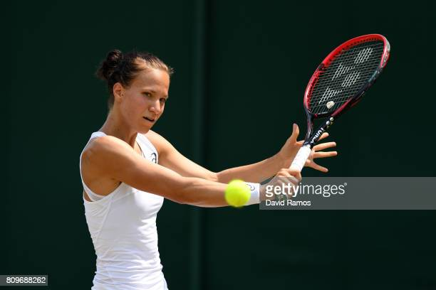 Viktorija Golubic of Switzerland plays a backhand during the Ladies Singles second round match against Lesia Tsuernko of Ukraine on day four of the...