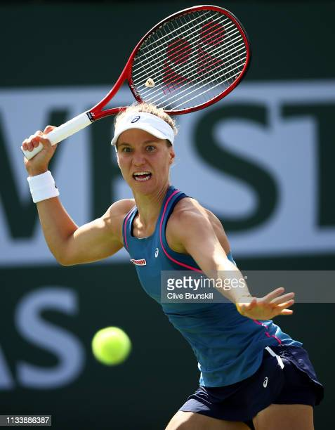 Viktorija Golubic of Switzerland plays a forehand during her straight sets victory against Katie Boulter of Great Britain in their second round...