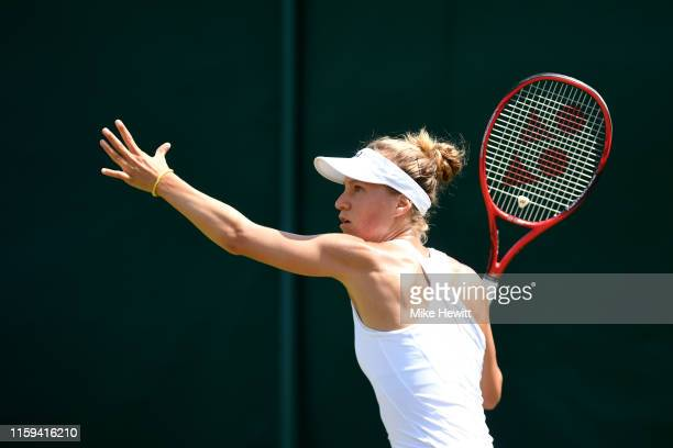 Viktorija Golubic of Switzerland plays a forehand in her Ladies' Singles first round match against Iga Swiatek of Poland during Day one of The...