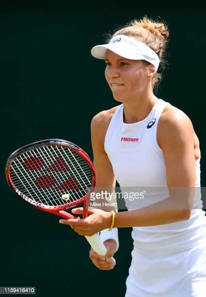 Viktorija Golubic of Switzerland prepares to return serve in her Ladies' Singles first round match against Iga Swiatek of Poland during Day one of...