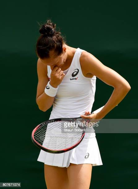 Viktorija Golubic of Switzerland reacts during the Ladies Singles first round match against Shuai Zhang of China on day two of the Wimbledon Lawn...