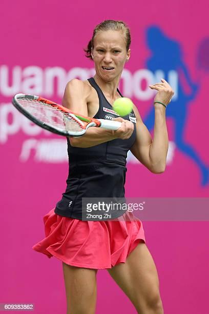 Viktorija Golubic of Switzerland returns a shot during the match against Denisa Allertova of Czech Republic on Day 2 of WTA Guangzhou Open on...