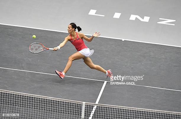 Viktorija Golubic of Switzerland returns the ball to Dominika Cibulkova of Slovakia during the final match at the WTA Ladies Tennis Tournament in...