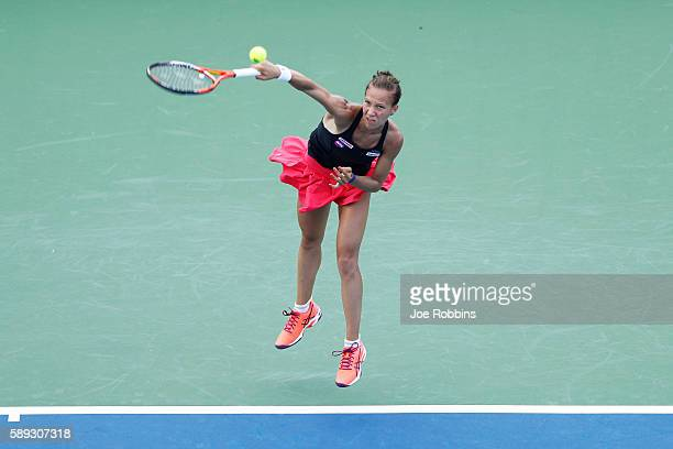 Viktorija Golubic of Switzerland serves to Lauren Davis of the United States during their qualifying match on Day 1 of the Western Southern Open on...