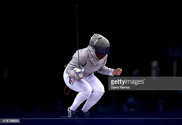 Viktoriya Kovaleva of Russia celebrates victory over Sara Balzer of France to win the bronze medal during the Women's Fencing Team Sabre Bronze Final...