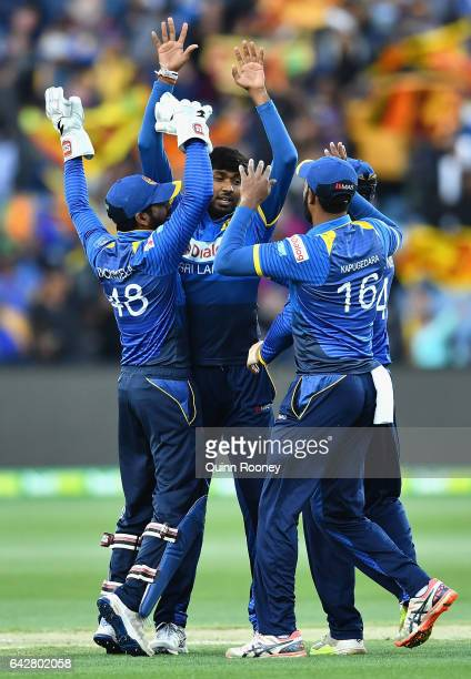 Vikum Sanjaya of Sri Lanka is congratulated by team mates after getting the wicket of Aaron Finch of Australia during the second International...