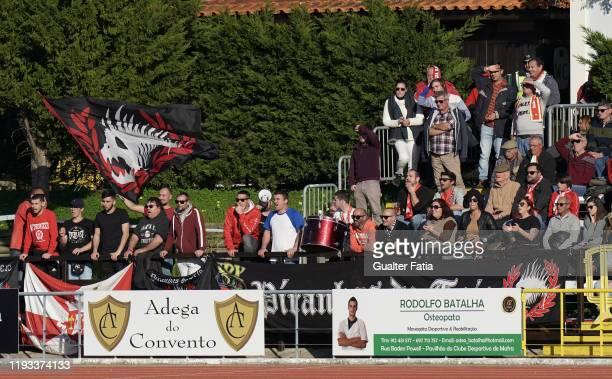 Vilafranquense supporters in action during the Liga Pro match between CD Mafra and UD Vilafranquense at Estadio do Parque Desportivo Municipal de...