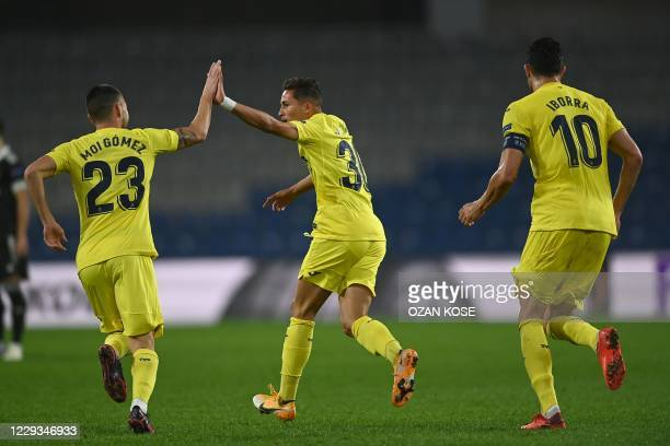 Vilareal's Spanish midfielder Yeremi Pino celebrates with teammates after scoring during the UEFA Europa League Group I football match between...