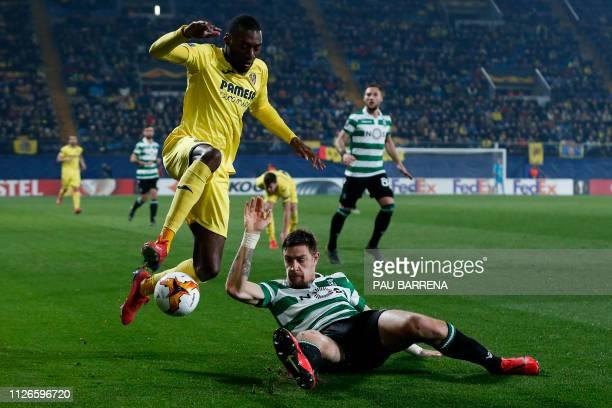 Vilarreal's Cameroonian forward Karl Toko Ekambi vies with Sporting's Uruguayan defender Sebastian Coates during the UEFA Europa League round of 32...