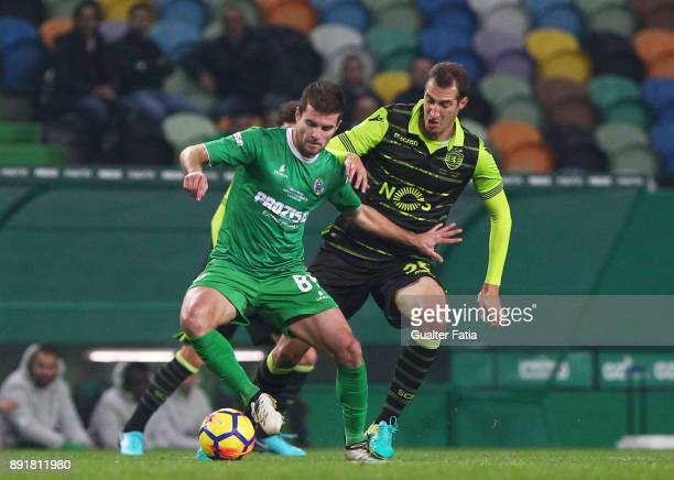 Vilaverdense FC forward Jose Pedro with Sporting CP midfielder Radosav Petrovic from Serbia in action during the Portuguese Cup match between...