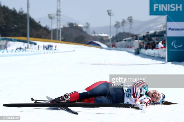 Vilde Nilsen of Norway collapses after crossing the finish line during the Women's 6 km Standing Biathlon competition at Alpensia Biathlon Centre on...