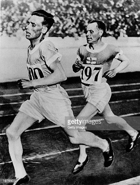 Vilho Ritola leads Paavo Nurmi during the 5000 meters at the 1928 Amsterdam Olympics.