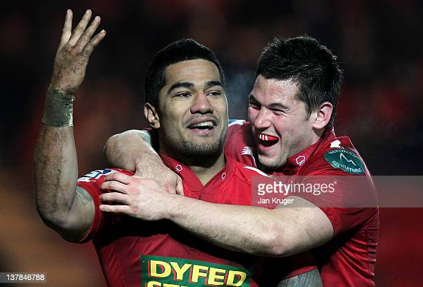 Vili longi of Scarlets celebrates his winning try with Dan Newton during the LV= Cup match between Scarlets and London Irish at Parc y Scarlets on...