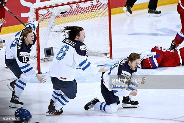 Vili Saarijarvi Joni Tuulola and Kasperi Kapanen of Finland celebrate after winning the 2016 IIHF World Junior Ice Hockey Championship final match...