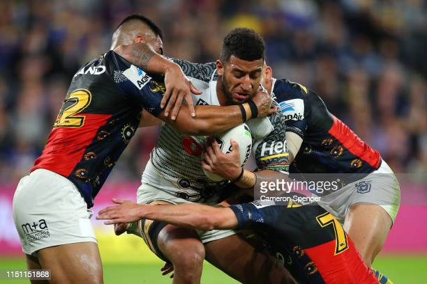 Viliame Kikau of the Panthers is tackled during the round 11 NRL match between the Parramatta Eels and the Penrith Panthers at Bankwest Stadium on...