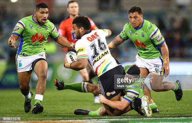 Viliame Kikau of the Panthers is tackled during the round 14 NRL match between the Canberra Raiders and the Penrith Panthers at GIO Stadium on June 8...