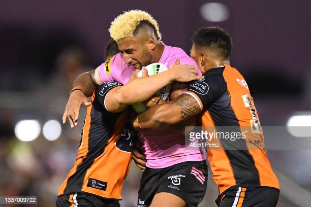 Viliame Kikau of the Panthers is tackled during the round 24 NRL match between the Penrith Panthers and the Wests Tigers at Moreton Daily Stadium on...