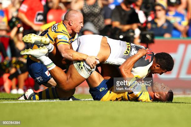 Viliame Kikau of the Panthers scores a try as he is tackled by Beau Scott and Jarryd Hayne of the Eels during the round one NRL match between the...
