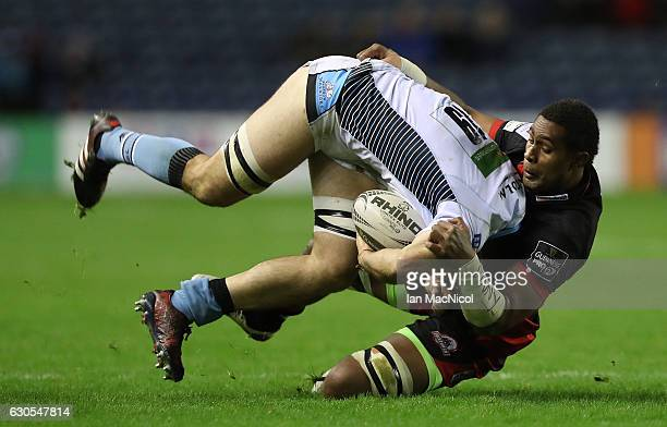 Viliame Mata of Edinburgh Rugby tackles Adam Ashe of Glasgow during the Guinness Pro 12 match between Edinburgh Rugby and Glasgow Warriors at...