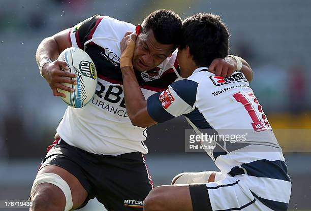 Viliami Fihaki of North Harbour is tackled by Tenina Sauileoge of Auckland during the round one ITM Cup match between Auckland and North Harbour at...