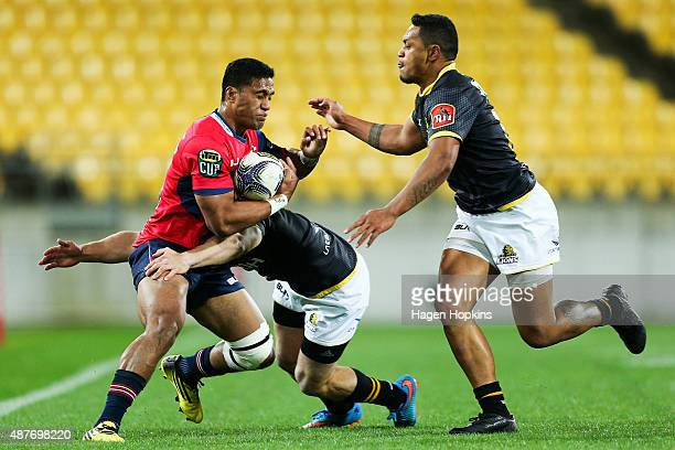 Viliami Lolohea of Tasman is tackled by Wes Goosen and Tomasi Alosio during the round five ITM Cup match between Wellington and Tasman at Westpac...