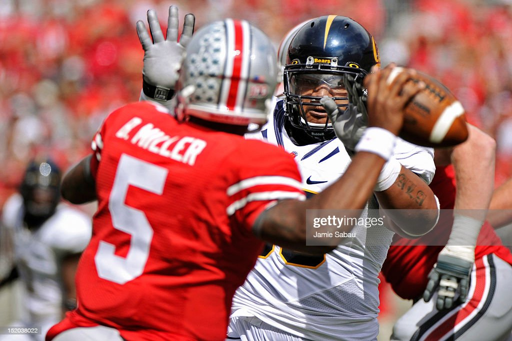 Viliami Moala #55 of the California Golden Bears applies pressure to quarterback Braxton Miller #5 of the Ohio State Buckeyes in the second half at Ohio Stadium on September 15, 2012 in Columbus, Ohio.