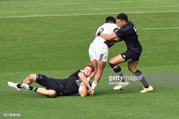 Vilimoni Koroi is tackled by Scott Curry and William Warbrick during the match between the All Blacks Sevens Black and All Blacks Sevens White at Sky...