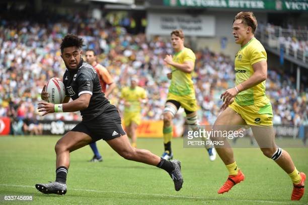 Vilimoni Koroi of New Zealand beats Charlie Taylor of Australia to score a try in their pool C match at the Sydney Sevens World Series tournament in...