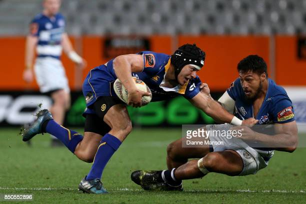 Vilimoni Koroi of Otago is tackled by George Moala of Auckland during the round six Mitre 10 Cup match between Otago and Auckland at Forsyth Barr...