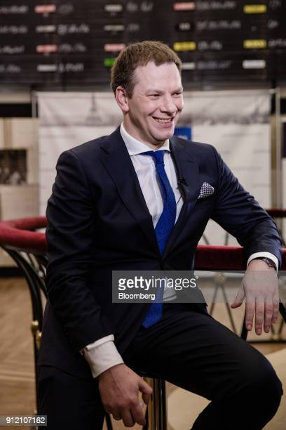 Vilius Sapoka Lithuania's finance minister reacts during a Bloomberg Television interview at the Paris Fintech Forum in Paris France on Tuesday Jan...