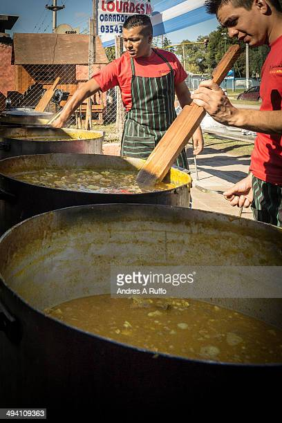 CONTENT] Villa Allende Argentina Small group of chefs cook for finishing Locro for sale to the public to commemorate Labor Day in the city street...