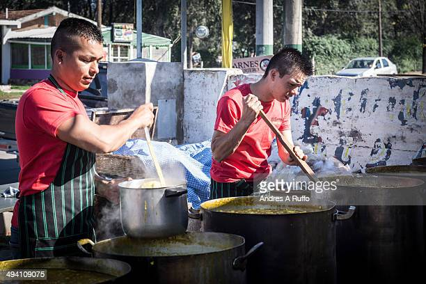 CONTENT] Villa Allende Argentina Small group of chefs to finish cooking Locro for sale to the public for the celebration of Labor Day by noon...