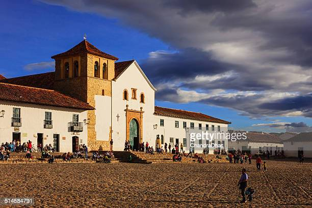 villa de leyva, colombia: the old church on the plaza mayor or main square in the historic 16th century andean town at sunset. copy space - cafe de colombia stock pictures, royalty-free photos & images