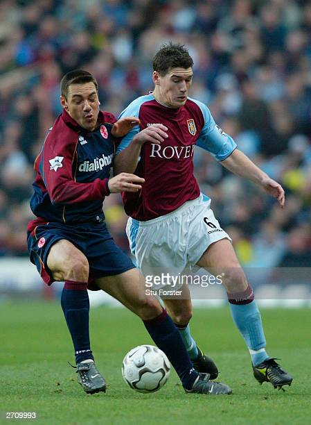 Villa defender Gareth Barry challenges Doriva of Middlesbrough during the Barclaycard Premiership match between Aston Villa and Middlesbrough at...