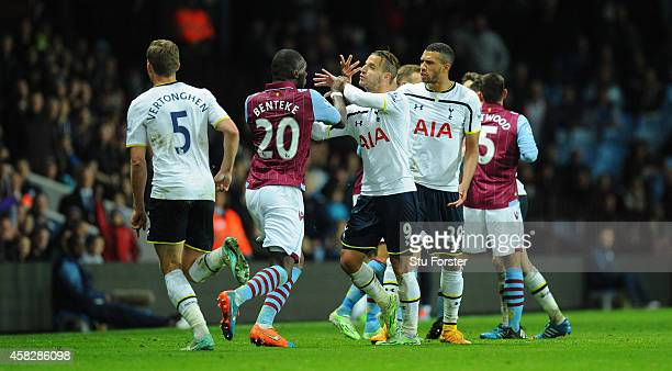 Villa player Christian Benteke confronts Roberto Soldado of Spurs before being sent off during the Barclays Premier League match between Aston Villa...