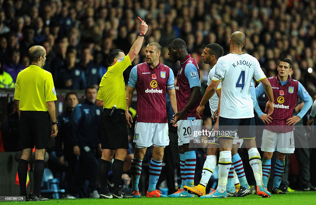 Villa player Christian Benteke (c) is sent off during the Barclays Premier League match between Aston Villa and Tottenham Hotspur at Villa Park on November 2, 2014 in Birmingham, England.
