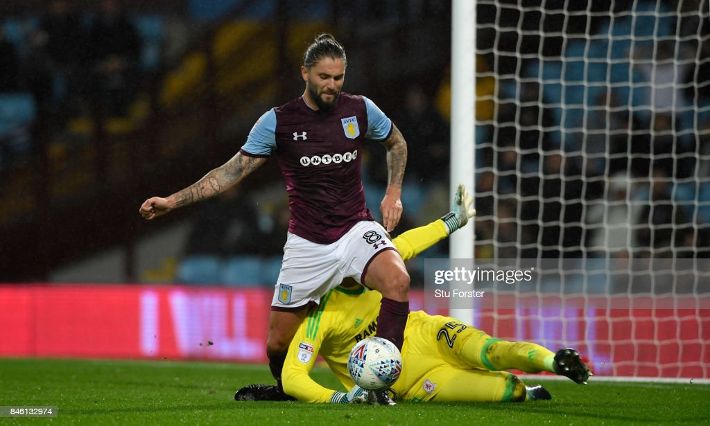 Villa player Henri Lansbury goes down under the challenge of Middlesbrough goalkeeper Darren Randolph during the Sky Bet Championship match between Aston Villa and Middlesbrough at Villa Park on September 12, 2017 in Birmingham, England.