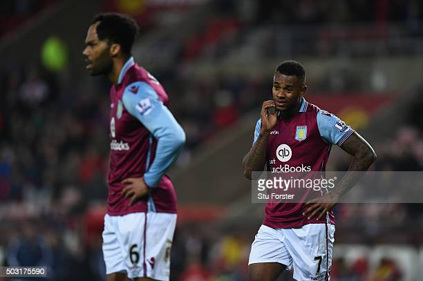 Villa players Joleon Lescott and Leandro Bacuna react during the Barclays Premier League match between Sunderland and Aston Villa at Stadium of Light...