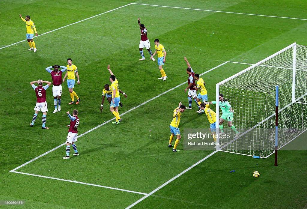 Villa players reacts as Julian Speroni of Crystal Palace watches an attempt by Christian Benteke of Aston Villa on goal go wide during the Barclays Premier League match between Aston Villa and Crystal Palace at Villa Park on January 1, 2015 in Birmingham, England.