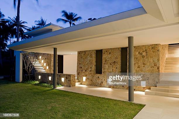 villa walkway - illuminated stock pictures, royalty-free photos & images