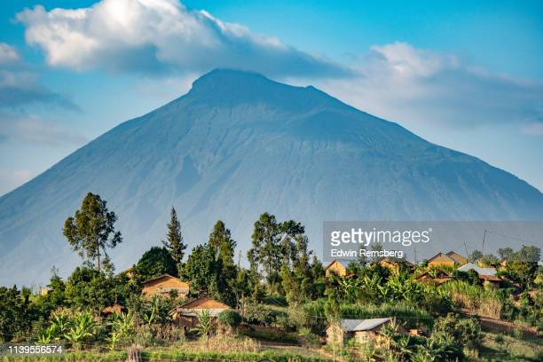 village and volcano - africa stock pictures, royalty-free photos & images