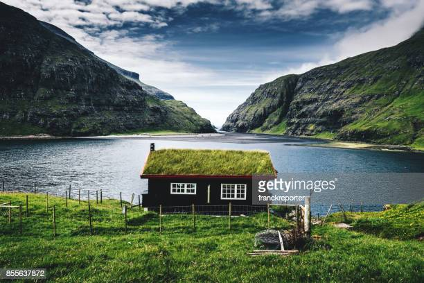 village at saksun with grass on the roof - nordic countries stock pictures, royalty-free photos & images