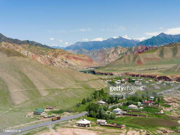 Village at the Pamir Highway. The mountain range Tian Shan or Heavenly Mountains. Asia. Central Asia. Kyrgyzstan.