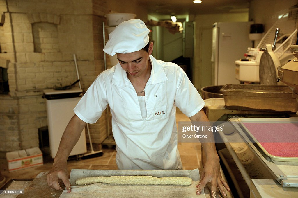 Village baker at work. : Stock Photo