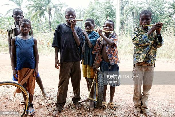 village boys with willow whistles. - togo stock pictures, royalty-free photos & images