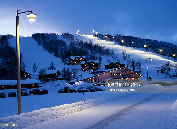Village by a ski slope.