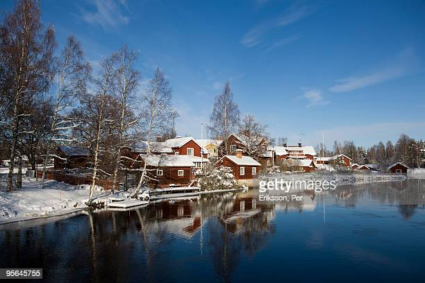 A village by a small river in the winter, Sweden.