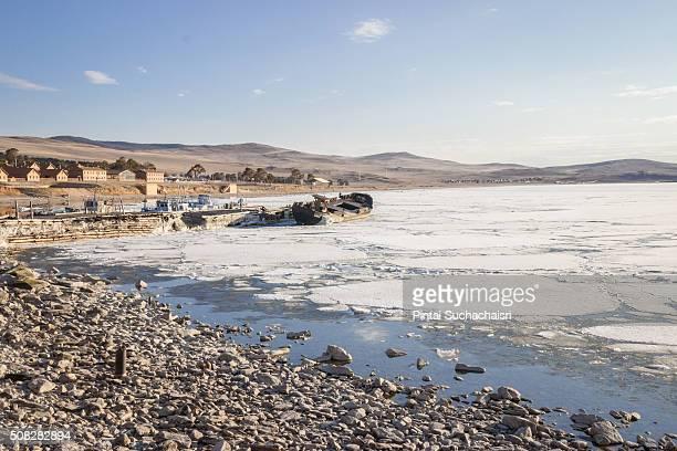 Village by the frozen Lake Baikal